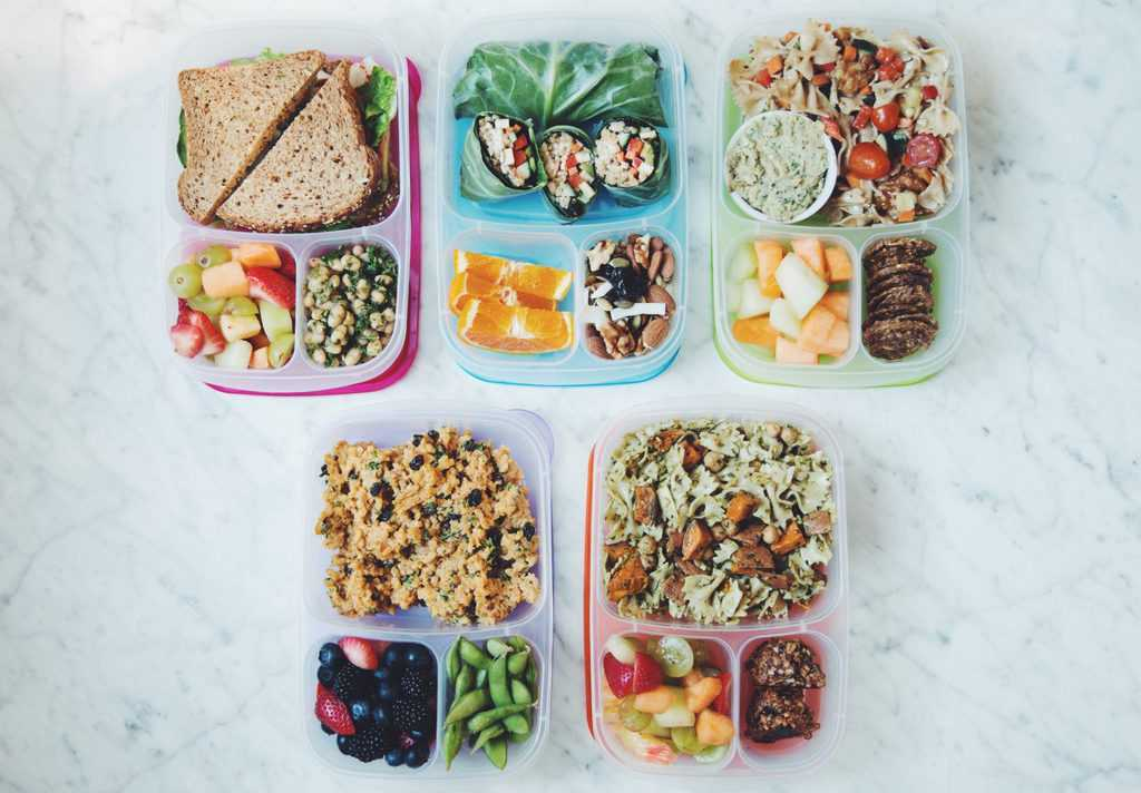 Fried tofu & veg sandwich, white bean pesto salad, and fruit salad Bento Box